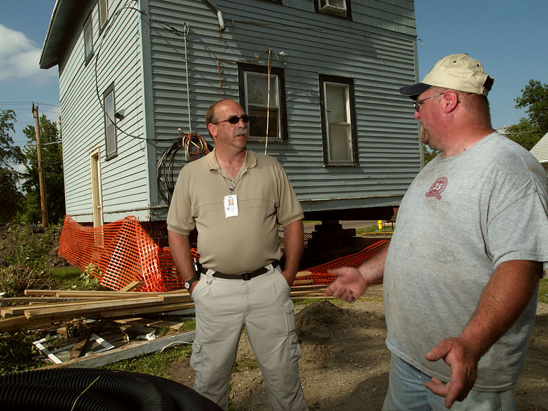 File:FEMA - 30884 - FEMA talking to a resident in South Dakota.jpg