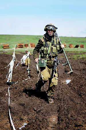 Demining - Israeli Combat Engineering soldier clears a minefield
