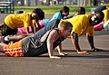 Flickr - Official U.S. Navy Imagery - A Sailor helps a child lead the count during a family day physical training session at the Naval Construction Battalion Center..jpg