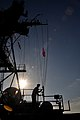 Flickr - Official U.S. Navy Imagery - USS Ponce Sailor hoists flag to signal underway replenishment..jpg