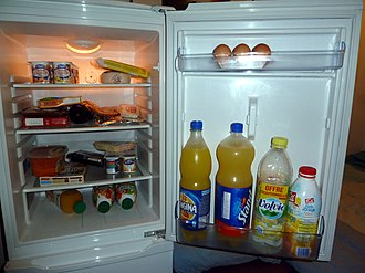 Refrigerator - Food in a refrigerator with its door open