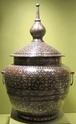 "Islam in Southeast Asia - A Muslim ""Food jar"" from the Philippines, also known as gadur, well known for its brass with silver inlay."