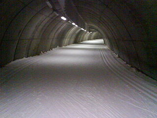 Indoor skiing climate controlled environment in which snow is manufactured using a snow cannon
