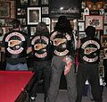 Four Hells Angels members display their jackets' 'colors'.jpg