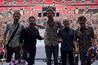 Dive Dive - Nigel Powell, Ben Lloyd and Tarrant Anderson on stage with Frank Turner and Turner's keyboard player, Matt Nasir, at Wembley Stadium, June 2010