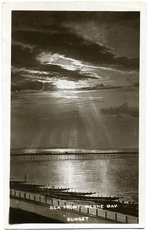 Frederick Christian Palmer - Sunset at Herne Bay, 1910–1916, by Fred C. Palmer. Probably taken from his studio window, using a filter to reveal clouds. The sun rays are enhanced by drawing on the glass negative