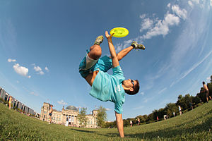 Flying disc freestyle - A professional freestyler performing an acrobatic maneuver