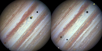 Galilean moons - Two Hubble Space Telescope views of a rare triple transit of Jupiter by Europa, Callisto and Io (24 January 2015).