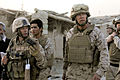 Gen. James Conway, commandant of the Marine Corps, and Lt. Col. William McCollough commander of 1st Battalion, 5th Marine Regiment, walk through the bazaar in Nawa district, Helmand province, Afghanistan 090824-M-RM405-182.jpg