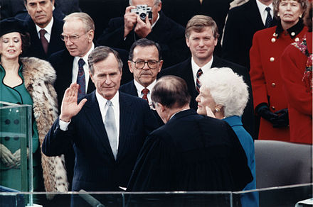 Chief Justice William Rehnquist administers the Presidential Oath of Office to George H. W. Bush during his inauguration ceremony at the United States Capitol on January 20, 1989. George H. W. Bush inauguration.jpg