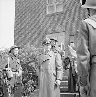 Alfred Jodl - General Jodl after his arrest under guard by British troops outside Flensburg 23 May 1945