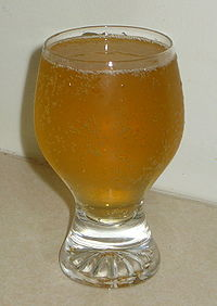 A glass of golden ginger ale