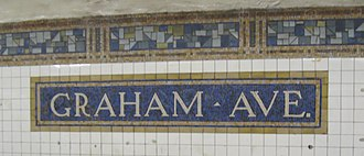 Graham Avenue (BMT Canarsie Line) - Station name tablet on the southbound platform