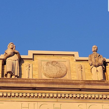Detail of the statues and reliefs adorning the front facade of the school. Due to years of student hijinks, the heads of the statues are reinforced by metal rods.[7]