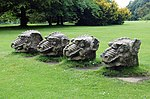 4 Stone Dragons Heads on Lawn East of Hall