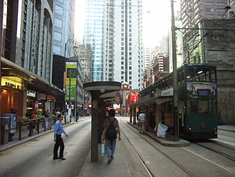 Tram stop - ... over stops threaded into narrow urban environments (here in Hong Kong)...