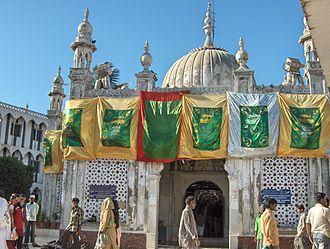 History of Mumbai - The Haji Ali Dargah at Mahalaxmi built in 1431, in honour of the Muslim saint Haji Ali
