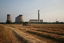 Harvesting in the shadow of the power station - geograph.org.uk - 209223.jpg