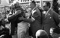 Hawthorn embraces Fangio Nurburgring 1957.jpg