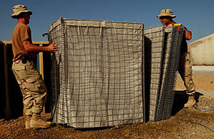 Jimi Heselden - Soldiers assembling HESCO bastions.