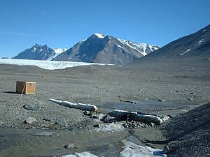 Stream gauge - December 12, 2001 photo of the USGS streamflow-gaging station at Huey Creek, McMurdo Dry Valleys, Antarctica.