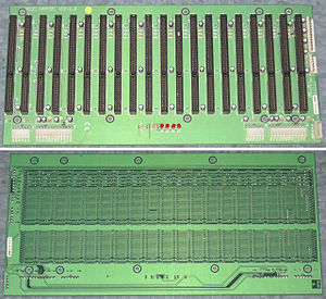 Backplane - ISA Passive Backplane showing connectors and parallel signal traces on back side. Only components are connectors, capacitors, resistors and voltage indicator LEDs.