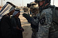 Iraqi police and U.S. Soldiers conduct a cordon and search DVIDS36770.jpg