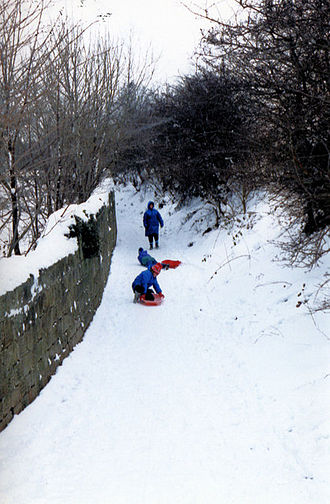 Winter of 1990–91 in Western Europe - People sledging in Darfield, South Yorkshire in February 1991.