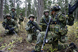 Japan Ground Self-Defense Force - JGSDF soldiers from the 22nd Infantry Regiment train with U.S. Army soldiers in a bilateral exercise at Fort Lewis' Leschi Town in October 2008.