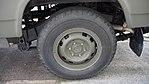 JGSDF Power Supply Vehicle(Nissan Safari, 04-1569) rear wheel(left) at Camp Akeno November 4, 2017.jpg