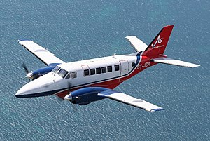 Jamaica Air Shuttle Beechcraft Model 99 In Flight.jpg