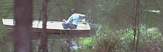 Jimmy Carter in boat chasing away swimming rabbit, Plains, Georgia - 19790420 (cropped).jpg