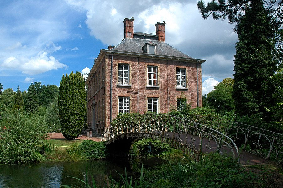 Southern facade of the Kasteel van Berlare (Castle of Berlare) with cast-iron bridge over the southern pond. Onroerend erfgoed, address: Dorp 1, Berlare, Belgium.