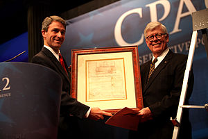 "Ken Cuccinelli - Cuccinelli receiving the ""Defender of the Constitution"" Award at the annual Conservative Political Action Conference in February 2012, for his work as Attorney General of Virginia."