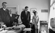 Kennedy, Johnson, and others watching flight of Astronaut Shepard on television, 05 May 1961