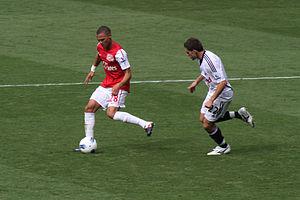 Àngel Rangel - Rangel defending against Kieran Gibbs of Arsenal in September 2011