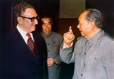 Kissinger, shown here with Zhou Enlai and Mao Zedong, negotiated rapprochement with the People's Republic of China. Kissinger Mao.jpg