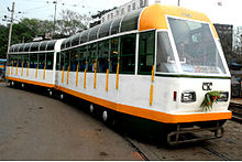 Two-car, white-and-orange tram