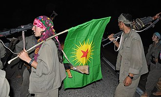 Kurdistan Communities Union - PKK fighters with KCK flag in Kirkuk, 2014