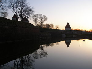 Kuressaare - Kuressaare castle towers over the moat at dusk