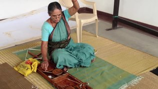 File:Lady yarn in a Charkha in Bangalore.webm