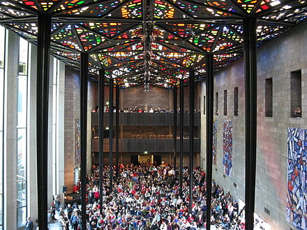 The world's largest stained-glass ceiling in the NGV's Great Hall, designed by Australian artist Leonard French Len French ceiling National Gallery of Victoria.jpg