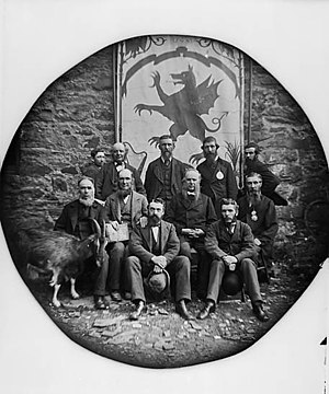 Free Borough of Llanrwst - An 1876 picture of the Llanrwst Poets in front of the Llanrwst coat of arms
