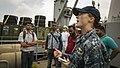 Lt. j.g. Dekotah Stonekeng explains amphibious capabilities of the amphibious dock landing ship USS Pearl Harbor (LSD 52) to local media during a scheduled port visit.jpg