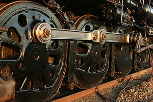 Driving wheel - The four driving wheels on one side of a 4-8-4 locomotive.