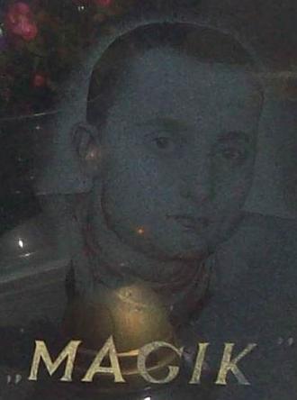 "Paktofonika - The portrait of Piotr ""Magik"" Łuszcz on his gravestone."