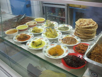 Maldivian cuisine - Different curries of the Maldives and parotha.
