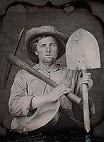 Man holding mining tools - 1851.jpg