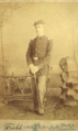 Man in uniform by Field of Tampa Florida.png
