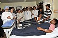 Manmohan Singh meets the injured persons, at the Rama Krishna Care Hospital, in Raipur, Chhattisgarh on May 26, 2013. The Chairperson, National Advisory Council, Smt. Sonia Gandhi and other dignitaries are also seen.jpg
